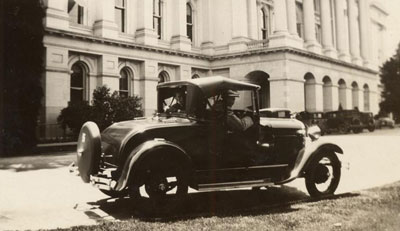 Automobile parked in front of the West side of the State Capitol building in 1929