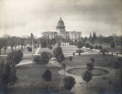 East side of the State Capitol building, dome and grounds circa 1904