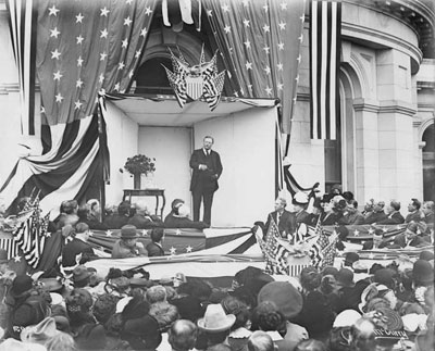 Theodore Roosevelt outside the east side of the State Capitol addressing a crowd circa 1903